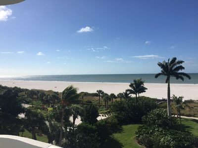 Photo for Sunrise and Moonrise Views from the Balcony of this Beachfront Cutie!