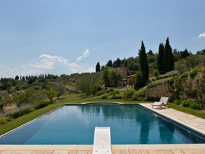 Photo for Rustic farmhouse with beautiful pool, gardens and views in central Tuscany