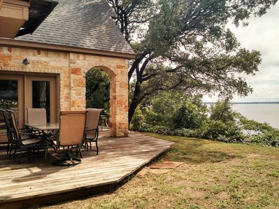 Outdoor dining area off living room deck overlooking Lake Whitney.