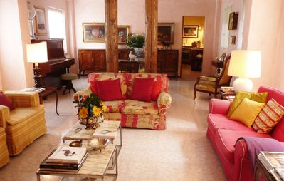 Large open space living and dining area with some antique furniture