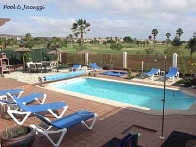 Photo for Air Conditioned Villa, Heated Pool, Jacuzzi, Fab Garden, Backing Golf Course.