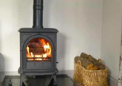 The toasty wood burning stove, made up and ready to light upon arrival!