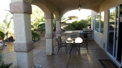 Backyard area below balcony with built in Griddle and BBQ