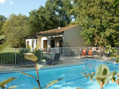 Photo for Bungalow in Pinsac with private swimming pool, garden and stunning view