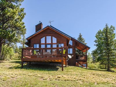 Photo for Secluded cabin near lakes with fantastic outdoor space and modern comforts