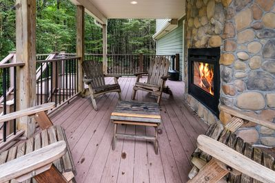 Outside porch and fireplace of our Pocono Getaway Rental