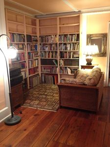 Front hall reading/listening nook: well-stocked, well lit, luxuriously comfy.