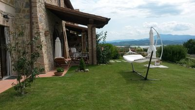 Photo for House surrounded by the Tuscan-Umbrian countryside. Lake view. private garden. Pool.