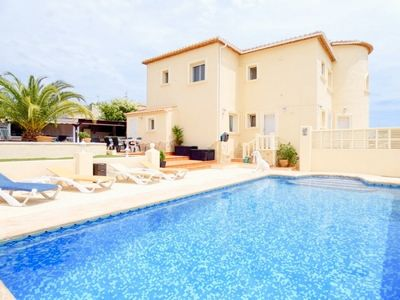 Photo for 5 Bed 10 min walk to beach  Heated Pool, Full A/C Wi Fi. Close to all amenities.
