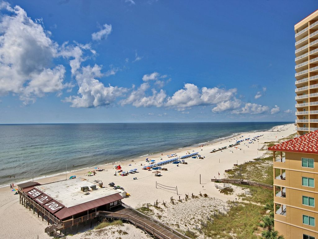 Boardwalk 983 - Tropical Beach Front Condo with Free Wi-Fi! Perfect for Couples, Friends & Families in the Heart of Gulf Shores, Perfect for Walking Everywhere. Outdoor Pool w/Huge Pool Deck.