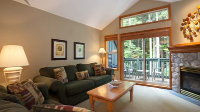 Generous Living Area with Forested View and Deck Access