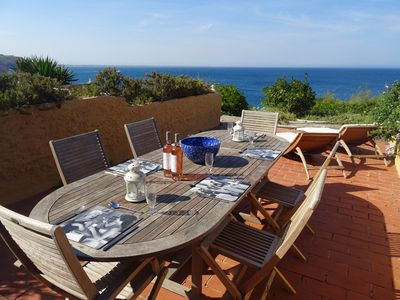 Photo for Seaside property with sun terrace, local beach and stunning sea views