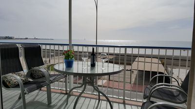 Photo for Bright apartment with terrace facing the sea