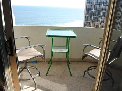 Photo for Bright, Colorful 2 Bedroom Oceanfront Condo with Outdoor Pool, WiFi, and Enclosed Balconies Located Uptown and Only Steps to Beach!