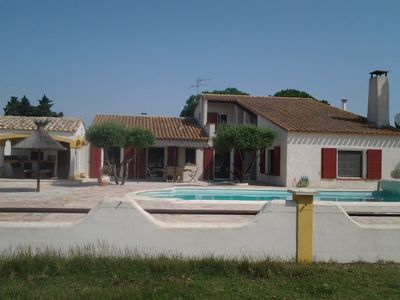 Photo for Farmhouse with pool, in the heart of the Camargue, 4 km from the village, closed