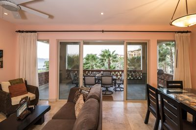 Large patio with furniture and gas grill