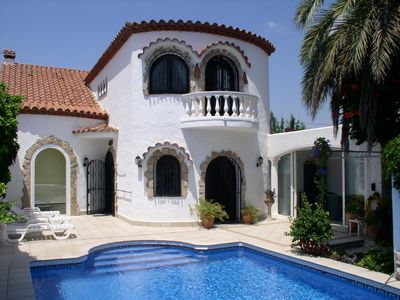 Photo for Spanish villa with tower on the canal in Empuriabrava with a lot of comfort, pool, air conditioning