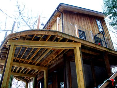 Our Tree House sits on two acres of trees and offers amazing views of the lake.