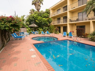 Photo for Casual and comfy condo with a shared pool, hot tub, and prime location!