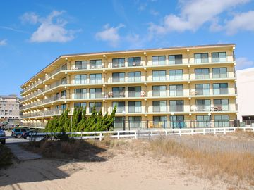 Traditional, stylish 2 bedroom oceanfront condo with free WiFi, and outdoor pool, and a stunning ocean view located in quiet midtown near mini golf and bowling and just steps from the beach!