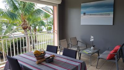 Photo for Spacious T2, with beach access, 2 swimming pools, in a tropical garden.