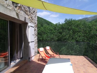 Photo for Stone house full nature renovated large terrace overlooking private access river