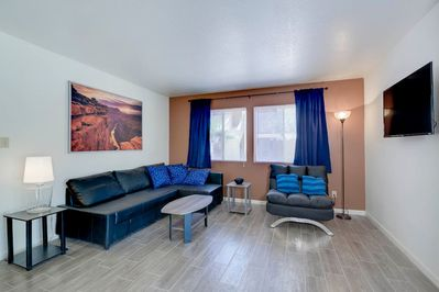 Well appointed Living Room. Leather couch converts to full/queen bed and single converts to small twin. All bedding provided.