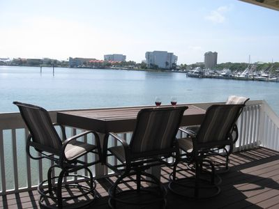 Enjoy dinner and cocktails on the back deck overlooking the Destin harbor