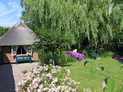 Photo for Quaint little thatched house, walking distance to beach