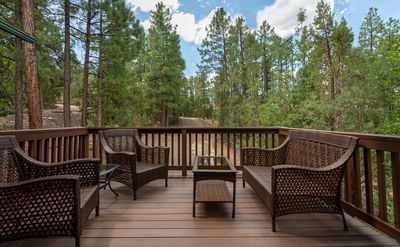 All year long the porch offers beaautiful views and the enticing smell of pine trees.