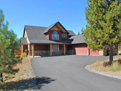 Photo for Lodge style home on Big Deschutes River, private hot tub and gorgeous views!