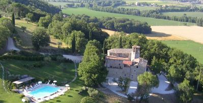 Photo for Pieve San Quirico castle- 7bd stone villa in Umbria with botanical garden and pool