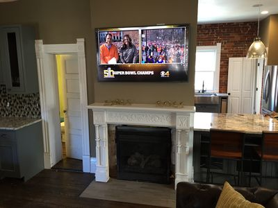 Living Room With 60 4K TV Above The Fireplace
