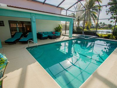 Photo for Newly listed! Covered Lanai w/360 degree rotating TV-Heated Pool/Spa w/lake views & 2 King Bedrooms