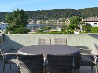 Photo for Two bedroom apartment with terrace and sea view Supetarska Draga - Donja (Rab) (A-2019-a)