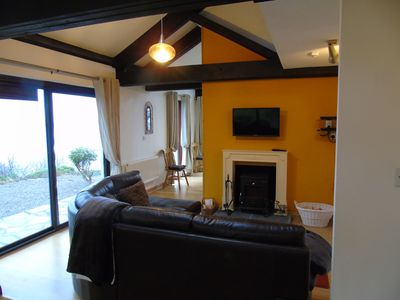 Cosy lounge with multi fuel stove and fantastic views