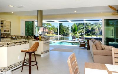 Photo for Stunning, spacious Villa on wide Canal, huge Pool area, close to the Beach