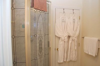 Private bathroom with bathrobes & slippers,