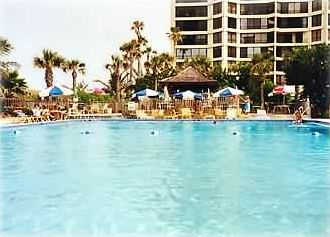 One of the three pools and the tiki bar on the ocean with kiddie pool