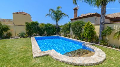 Photo for Cosy villa with BBQ and garden, near the beach