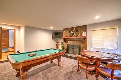 Home highlights include a game room, private hot tub, patio, gas grill, + more!