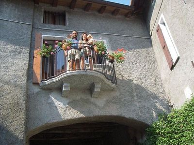 Fabio and family greets you from the flowered Balcony
