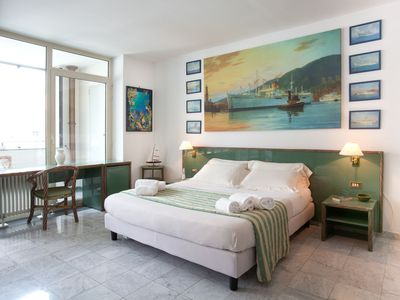 Photo for Beautiful apartment with terrace on the harbor - Genoa