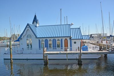 Floating chapel with front and rear decks.