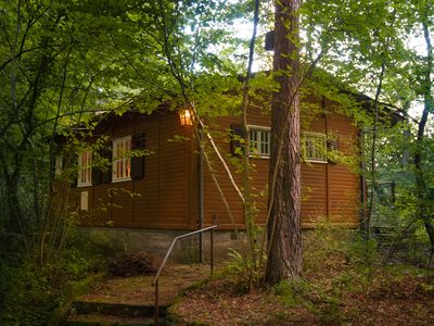 Photo for Forest cottage with sauna and fireplace in a romantic location, right on the river.