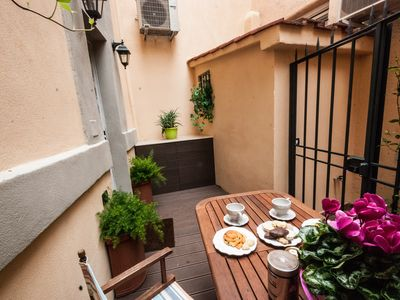 Photo for LOVELY TERRACE IN TRASTEVERE - cozy split level apartment