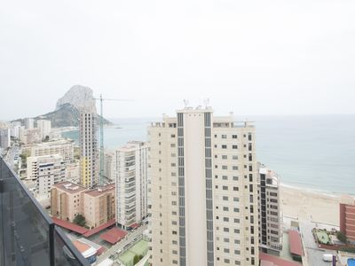 Photo for Beautiful penthouse with frontal sea views on the sandy beach in Calpe