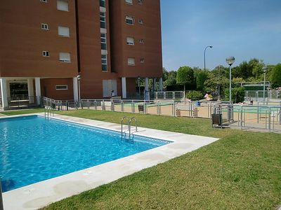 Photo for 4 bedroom Apartment, sleeps 7 with Pool, Air Con and Walk to Shops