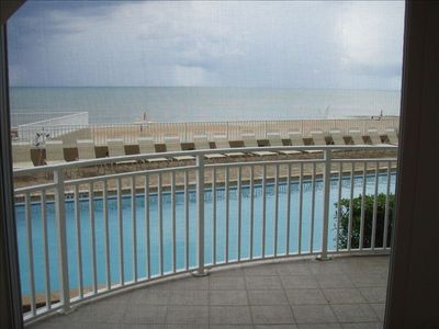 Looking over pool to ocean from inside living room.