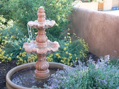 The trickling water in the fountain is so relaxing while out in the lush yard.